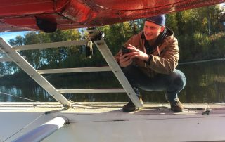 Devin Boyle installing GoPro camera on a floatplane