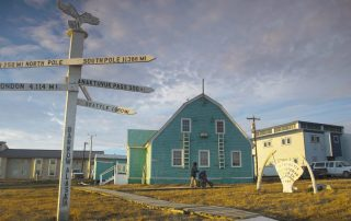 a sign in Utqiagvik (Barrow), Alaska denoting the distances to various places including Seattle
