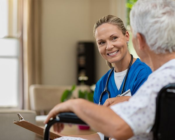 stock photo of a nurse interacting with an elderly patient