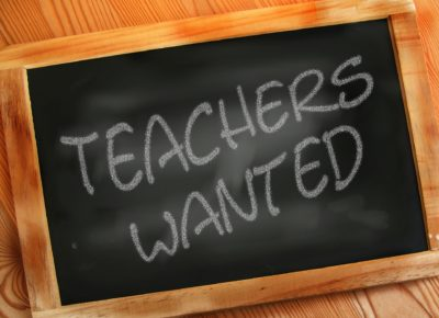 small chalkboard that says teachers wanted