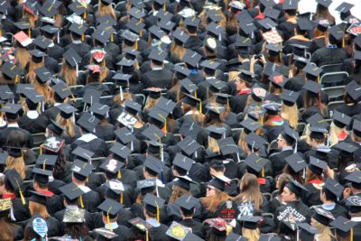 students wearing mortarboards at graduation