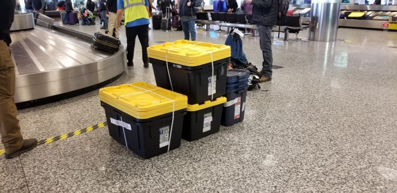 stacked totes in an airport